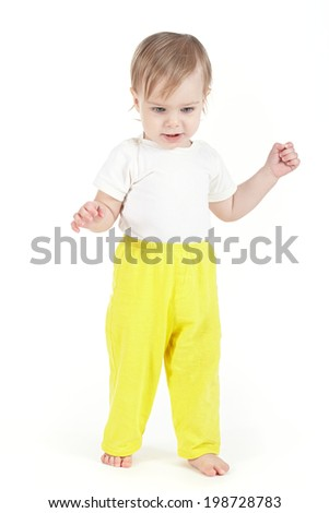 Little baby taking its first steps - stock photo