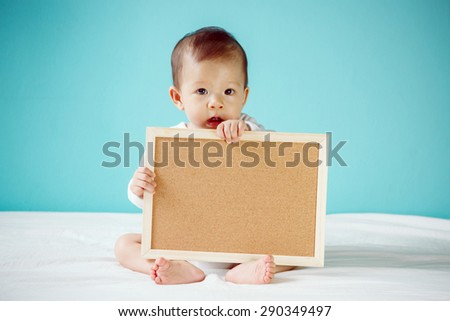 Little baby with brown panel, new family and love concept. - stock photo