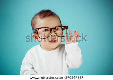 Little baby with Glasses, new family and love concept. - stock photo