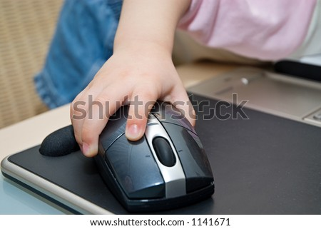 Little baby working on notebook - stock photo