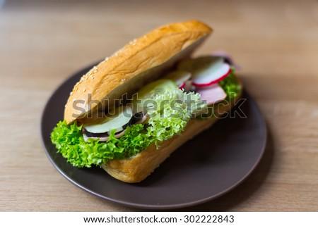 Little baguette fresh and delicious sandwich - stock photo