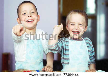 Little Bakers and Flying Flour. - stock photo