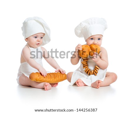 Little bakers babies boy and girl isolated - stock photo