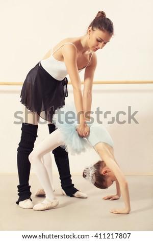 Little ballerina have class with personal ballet teacher in dance studio.  - stock photo