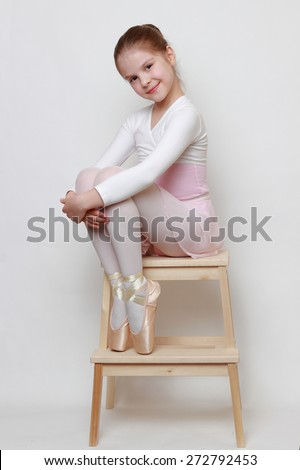 Little ballerina in pointe shoes - stock photo
