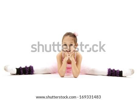 little ballerina, posing in studio, white background - stock photo