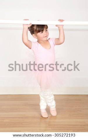Little ballet girl dancing at the studio - stock photo
