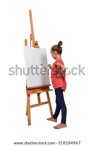 little barefoot girl artist drawing on easel - stock photo