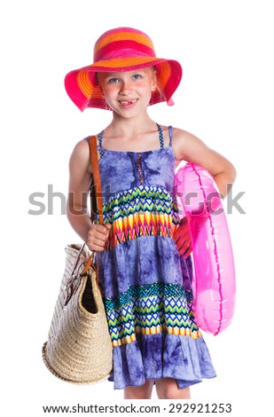 Little beach girl is dressed in summer dress, sunglasses and hat. Isolated On White Background. - stock photo