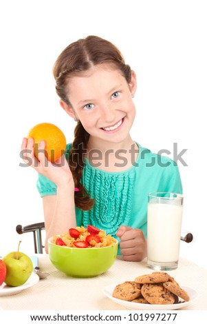 little beautiful girl have a breakfast on white background - stock photo