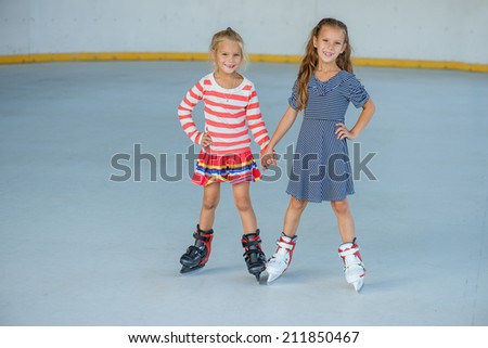 Little beautiful girl ice skating at stadium. - stock photo