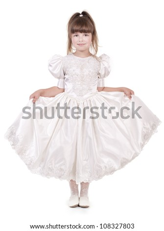 Little beautiful girl in the fashion dress - stock photo
