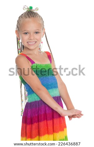 Little beautiful girl on a white. Girl is six years old. - stock photo