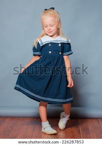 Little beautiful girl portrait in studio - stock photo