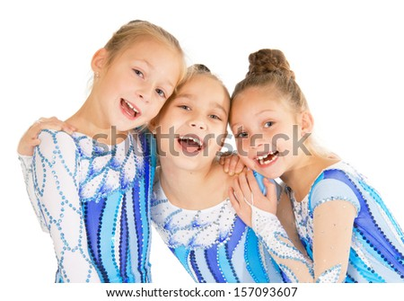 Little beautiful gymnasts - stock photo