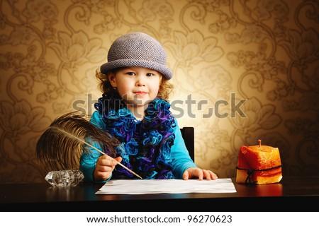 little beautiful vintage writer girl - stock photo