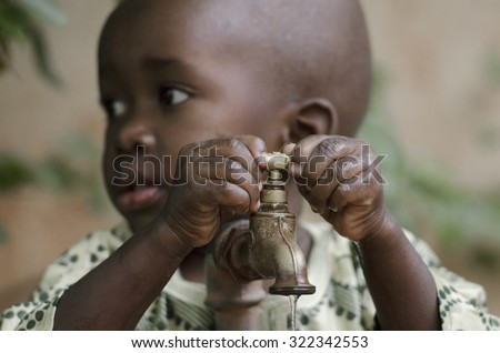 Little black boy asking begging for clean water. Its scarcity affects every continent. Around 1 billion people, live in areas of physical scarcity, and many more people approach this situation. - stock photo