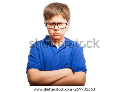 Little blond boy with arms crossed looking all mad against a white background - stock photo