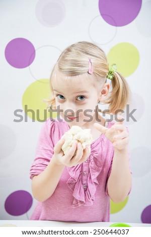 little blonde girl make cake, have fun - stock photo