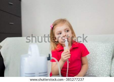 little blonde girl of three - four years is ill, is treated with a nebulizer, cough - stock photo