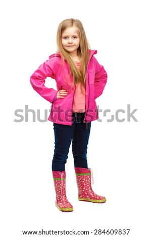 Little blonde girl with long hair fashion posing on white background. Studio portrait of child girl. - stock photo