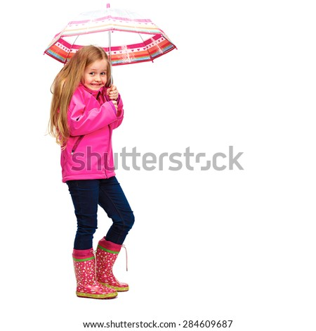 Little blonde hair girl standing against white background with umbrella. Isolated studio portrait of girl in pink clothes. - stock photo