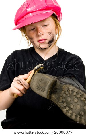 little bootblack girl is shining up the shoes isolated on white - stock photo