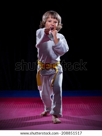 Little boy aikido fighter on black - stock photo