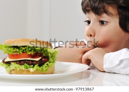 Little boy and burger - stock photo