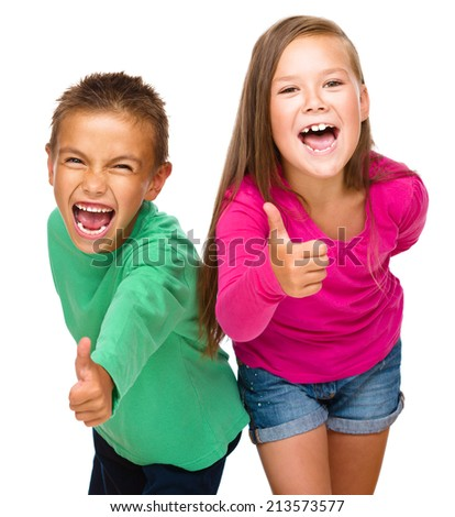 Little boy and girl are showing thumb up sign, isolated over white - stock photo