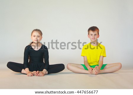 little boy and girl  doing yoga on white background - stock photo