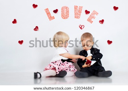 Little boy and girl portrait in studio - stock photo