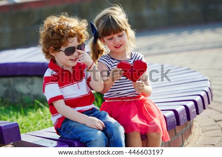 little boy and girl with heart - stock photo