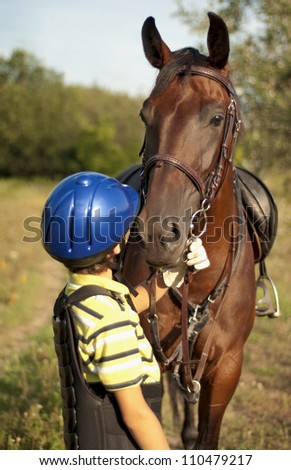 little boy and her best friend on the field - stock photo