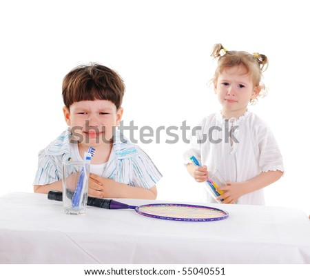 little boy and his sister cry - stock photo