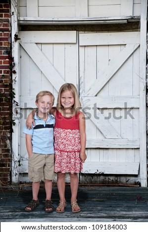 Little boy and little girl best friends - stock photo
