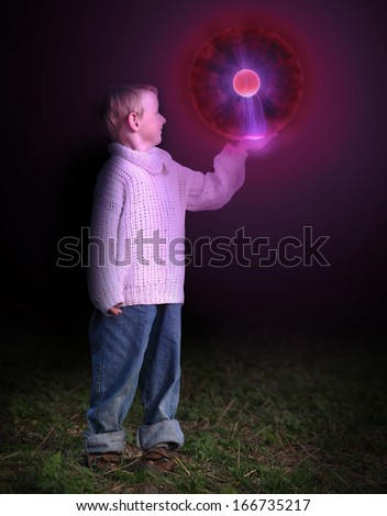 Little boy and UFO in the night. - stock photo
