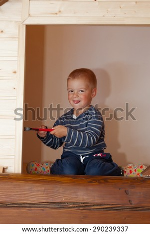 Little boy as a construction worker with pincers. - stock photo