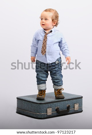 Little boy as boss manager - businessman - stock photo