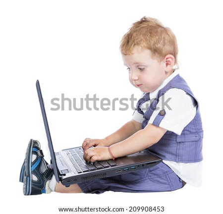little boy at the computer on a white background - stock photo