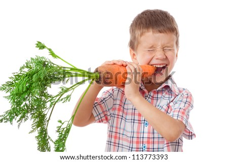 Little boy biting the carrot, isolated on white - stock photo