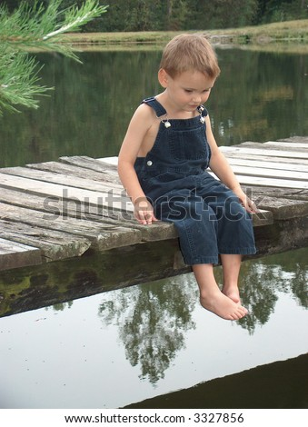Little boy overalls stock photos images pictures for Little boy fishing