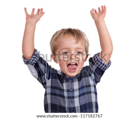 Little boy cheering with his arms raised in the air - stock photo