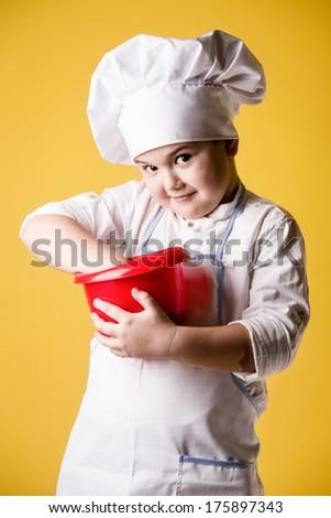 Little boy chef in uniform - stock photo