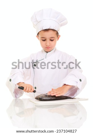 Little boy chief gutting fish isolated on white - stock photo