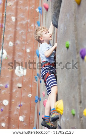 little boy climbing in indoor gym - stock photo