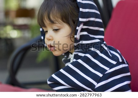 Little boy concentrated - stock photo