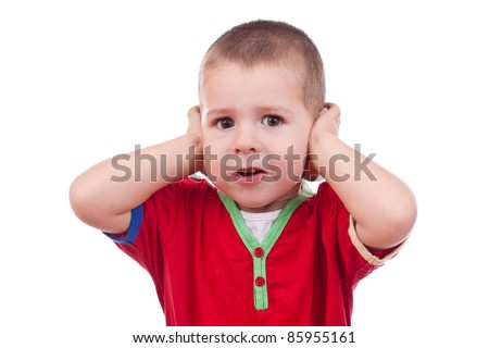 Little boy covering her ear with her hand - stock photo