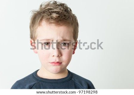 Little boy crying - isolated on white - stock photo