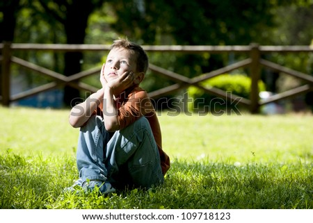 Little boy deep in thoughts - stock photo